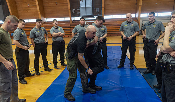 City of Ogdensburg Patrolman Ryan Polniak demonstrates arrest techniques with cadet Joshua Belile during a class in the David Sullivan-St. Lawrence County Law Enforcement Academy.