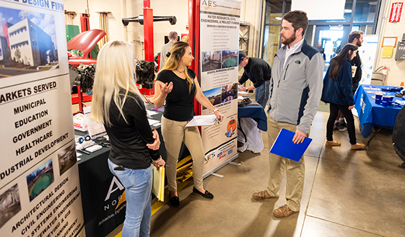 A student speaks with AES representatives about job opportunities at the 2019 Career Fair.