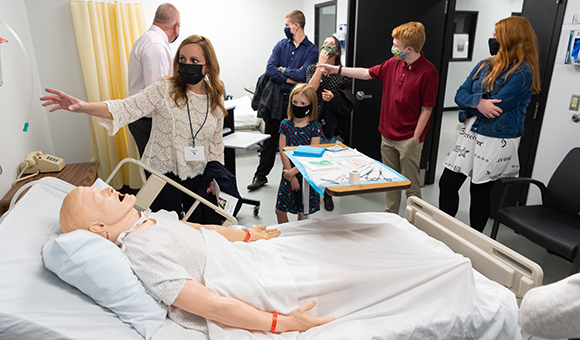 Members of the Caswell family tour the simulation labs, which feature computer-controlled nursing manikins.
