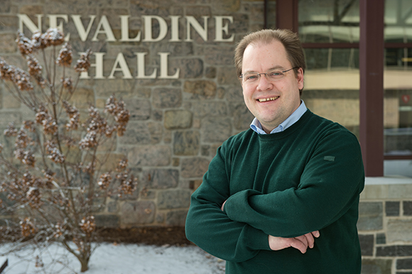 Fulbright scholar Johannes Brombach stands in front of Nevaldine Hall
