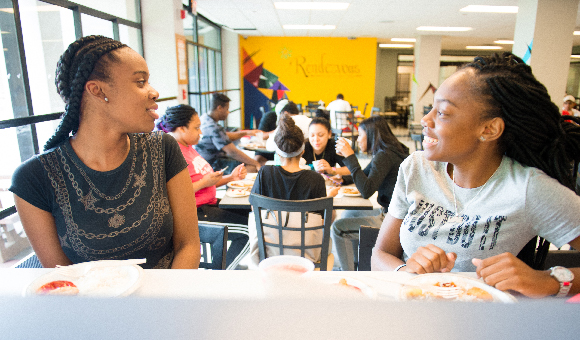 Students laugh and enjoy lunch at Rendezvous