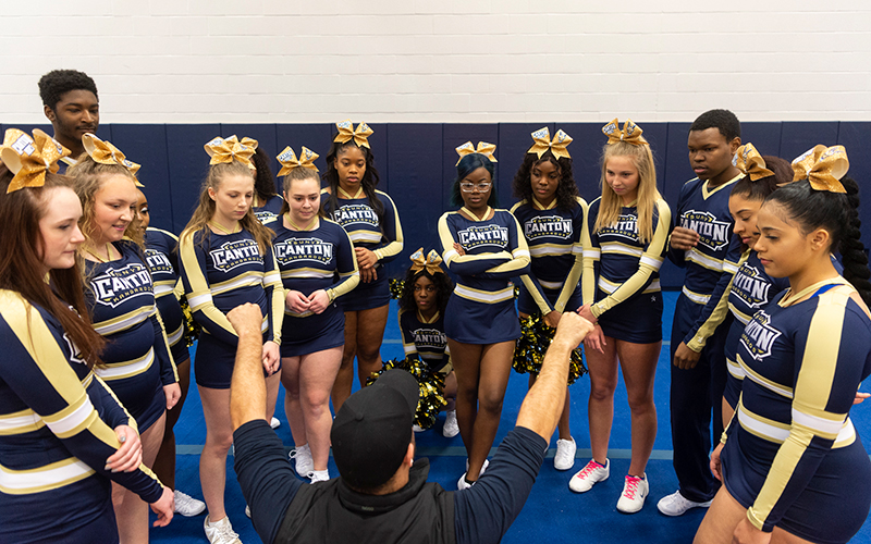 SUNY Canton cheerleading team receives guidance from coach Joey Boswell.