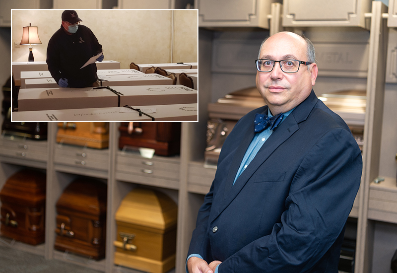 David Penepent stands in front of caskets in the Funeral Services Lab. Inset - Penepent examines boxes of remains in NYC.