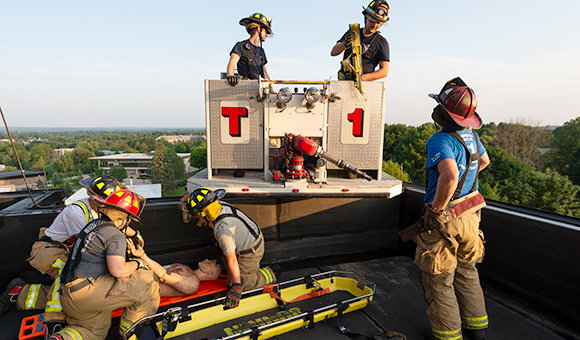 Canton Firefighters practice a rooftop extraction from the top of MacArthur Hall.