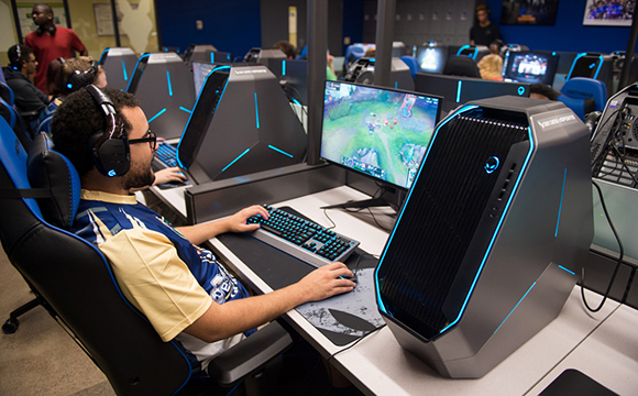 A group of students play League of Legends in the all-new eSports Arena.