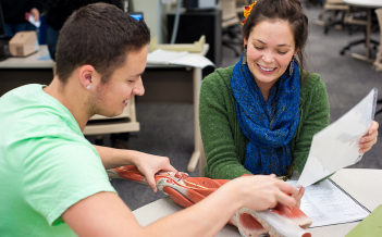 Two students study human anatomy in the Tutoring Center.