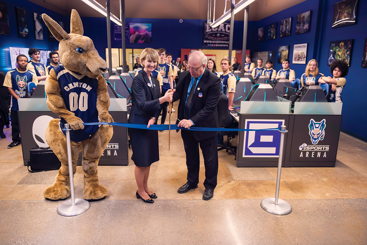 The Chancellor helps President Szafran and Roody cut the ribbon at the eSports Grand Opening.